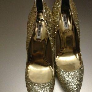 Miu Miu gold stilettos
